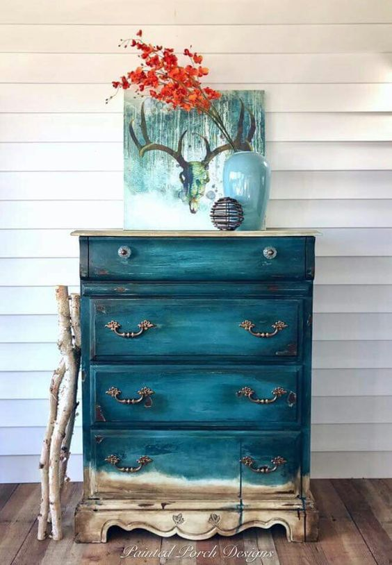an old sideboard renovated with teal with a gradient effect is really worth crafting