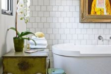 13 bold blue and yellow mosaic tiles on the floor set the tone in the bathroom, and white tiles on the wall just calm them down