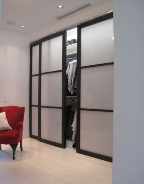 sliding doors with black framing and frosted glass is a stylish and very modern idea to try