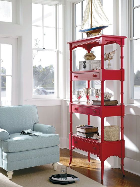 a bright etagere made up of several simple console tables is a cool furniture idea