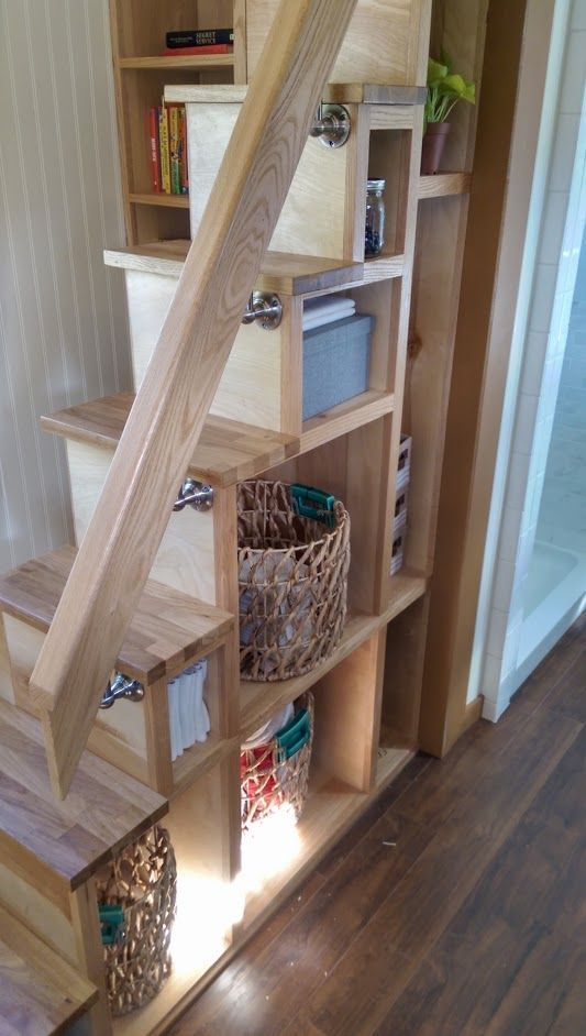 a ladder with incorporated storage features two functions at the same time
