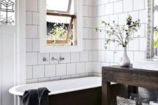 14 bold mosaic tiles with catchy patterns and white tiles on the walls that accent the floors even more