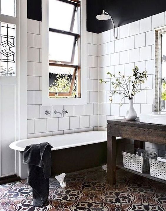 bold mosaic tiles with catchy patterns and white tiles on the walls that accent the floors even more