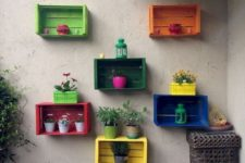 Knagglig boxes painted in bold shades and attached to the wall can be used as an outdoor garden