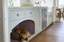 15 a kitchen cabinet with an integrated dog bed for him or her to stay by your side while you are cooking