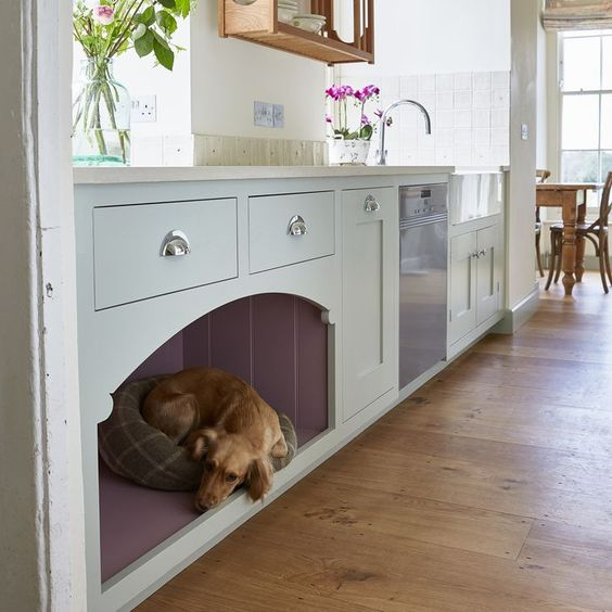 a kitchen cabinet with an integrated dog bed for him or her to stay by your side while you are cooking
