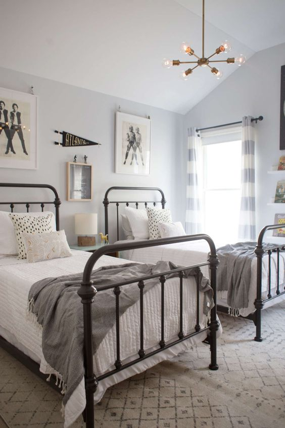 a neutral guest bedroom with two beds and touches of vintage here and there
