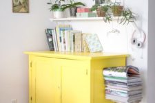 15 a sunny yellow sideboard will make a colorful statement in a neutral or monochromatic space giving it a mood