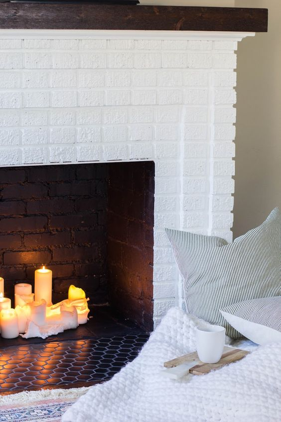 if it's a faux fireplace, think of filling it with candles to make it look more natural