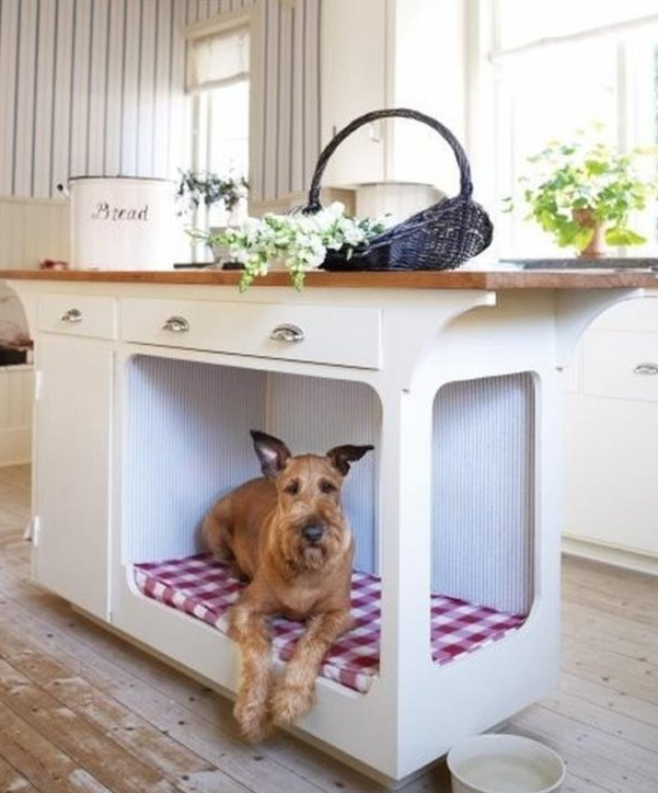 a kitchen island with a dog bed that is built in is a cool way to let your pet be around without preventing you from cooking