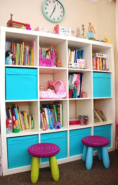 an Expedit shelving unit finished off with colorful IKEA Drona boxes for closed storage