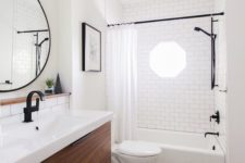 16 chic black and white mosaic tiles on the floor and white subway tiles with black grout on the walls for a bold look