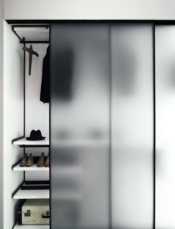 cover your closet with frosted sliding doors to make it hidden but to avoid a builky closet look in your bedroom