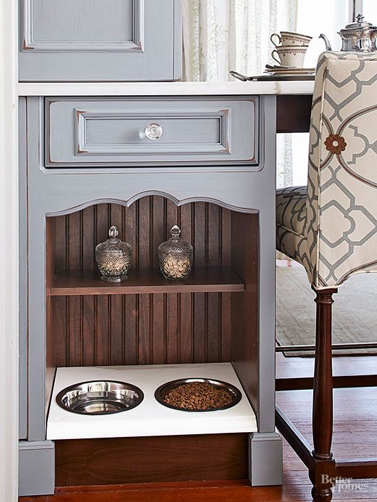 a cabinet with a elegant pet food station and some jars with treats on the shelf