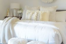 17 a cozying up printed rug, faux fur stools and fur throw blankets make the bedroom very inviting