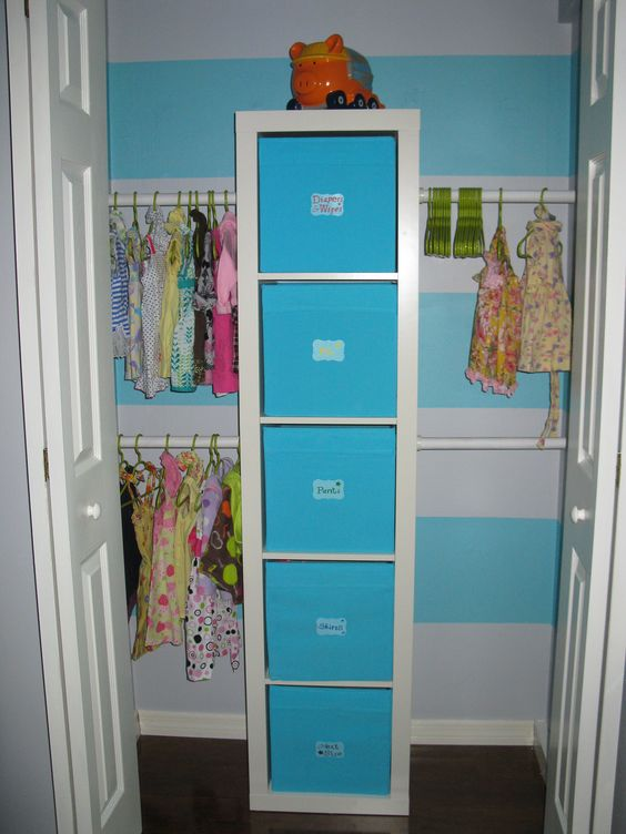an IKEA Expedit shelf with Drona boxes and labels is a great option for a kid's closet