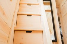 17 if you have a sleeping space on the second level, incorporate storage drawers into the ladder