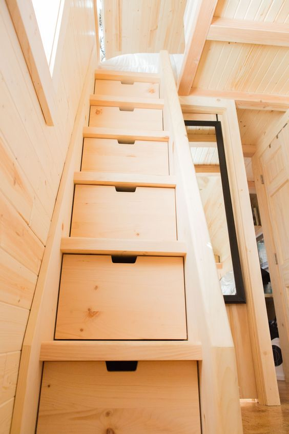 if you have a sleeping space on the second level, incorporate storage drawers into the ladder