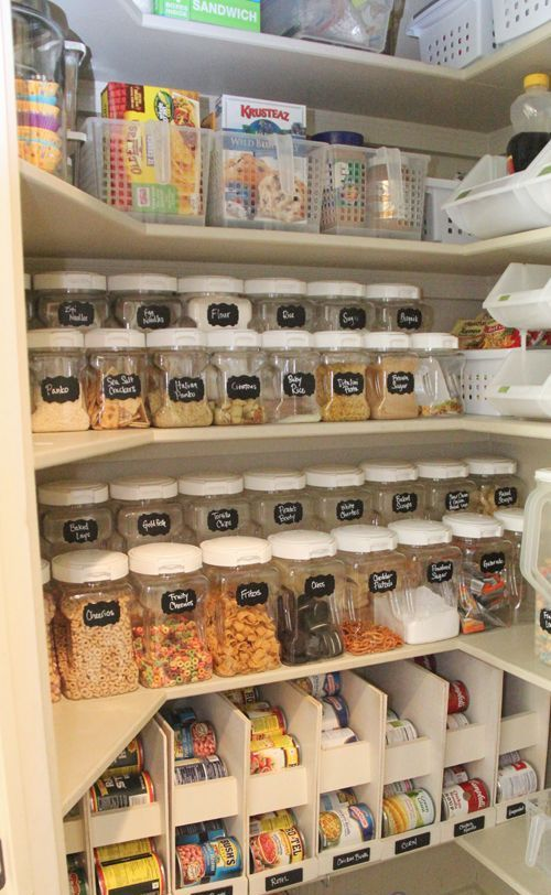smaller and larger jars with labels and open drawers with the same labels give your pantry a cohesive look