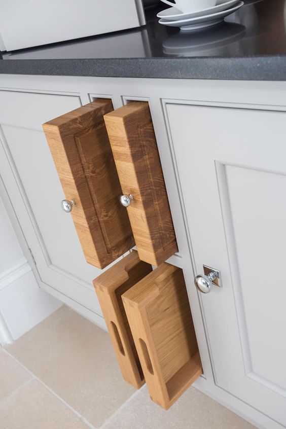 store your cutting boards inside a cabinet making just some holes for them
