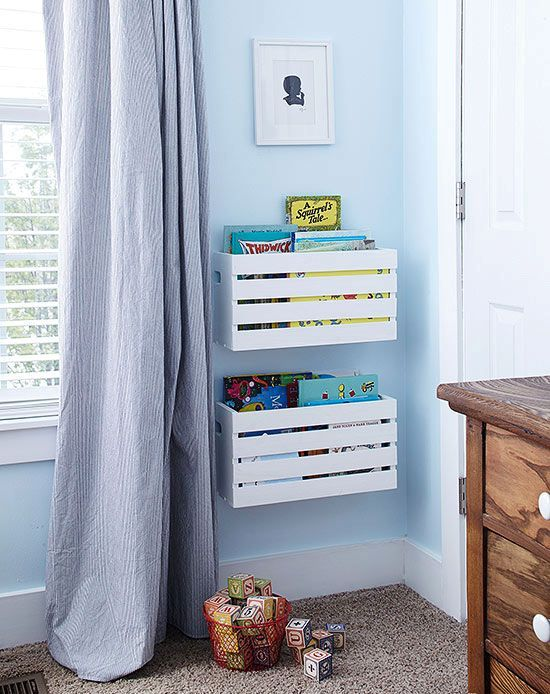 white Knagglig boxes attached to the wall make up cool toy and book storage easily