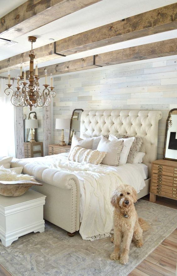 a neutral space with a neutral rug and a fringed blanket and fur pillows