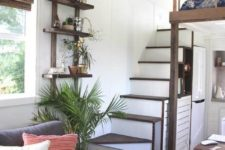 18 an open shelving unit allows using an awkward corner between the ladder and the sofa