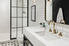 18 hex penny tiles forming floral patterns on the floor and neutral white subway tiles with black grout on the walls