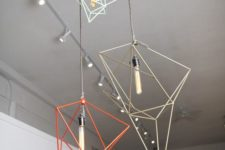 19 a bunch of geometric pendant lamps in various colors will make your space different