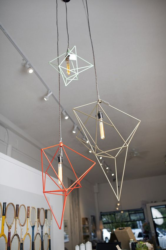 a bunch of geometric pendant lamps in various colors will make your space different