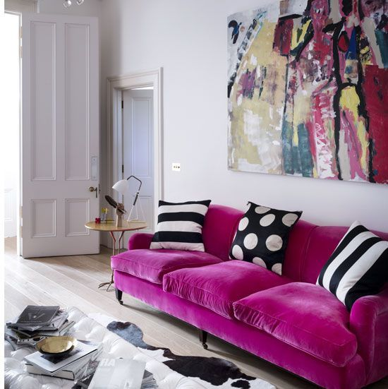 a hot pink velvet sofa is a bright colorful statement for every living room