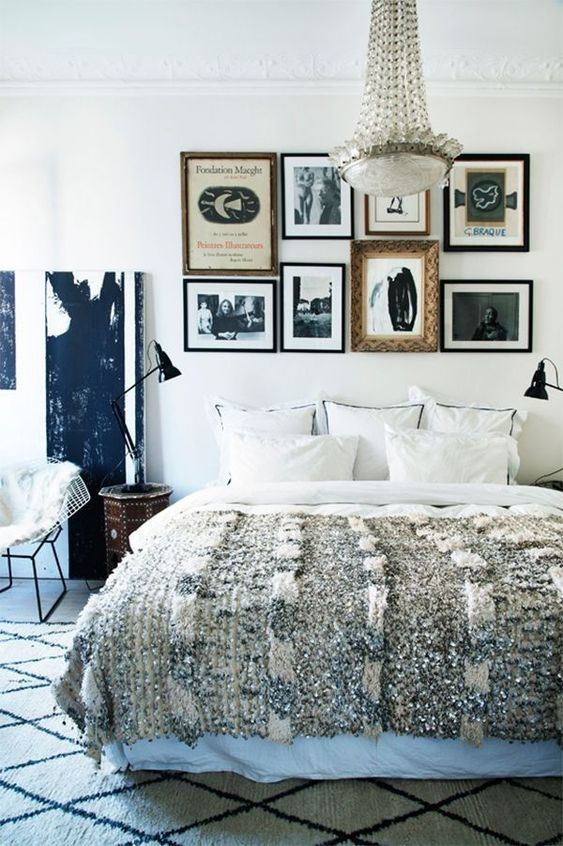 a printed rug and a fur throw are sure to make the bedroom more winter-like and cozier