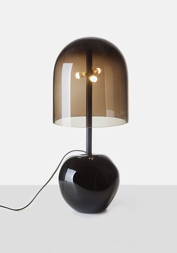 a stylish and bold modern table lamp with a black glass base and a smoked glass lampshade for a contemporary space