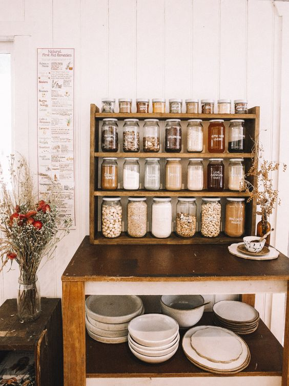 an open pantry idea with a shelving unit or several ones and the same jars with sharpie labels
