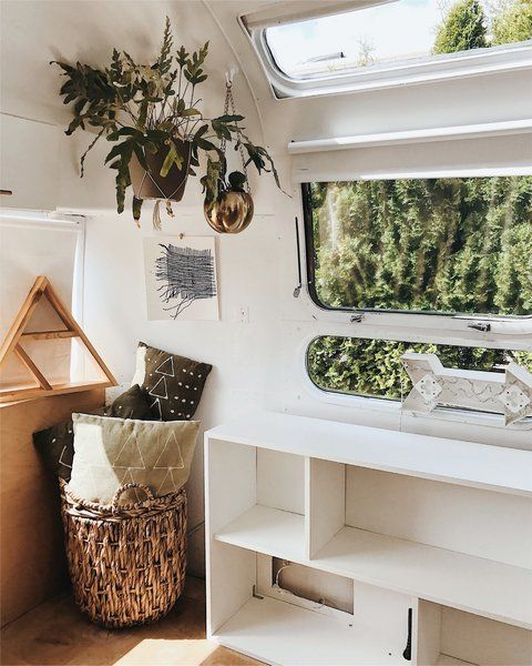 an open shelving system under the window is a great piece to use for storage