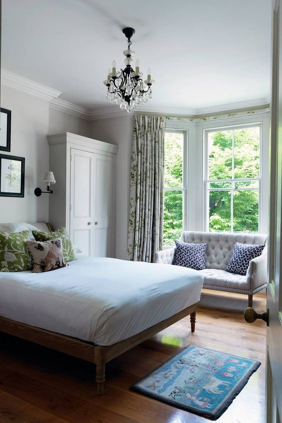even if your bedroom is small, you may place a small loveseat at the window anyways