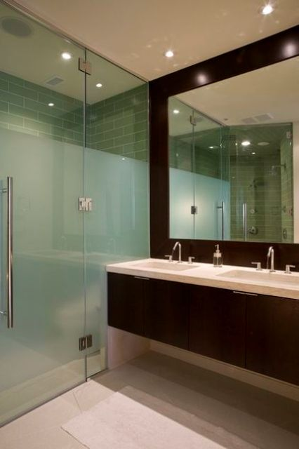 separate the shower space from the rest of the space, with frosted glass and usual glass for a catchy look