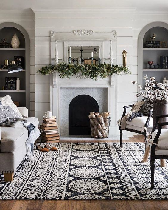 a black and white patterned rug completes the room and adds itnerest with texture and patterns