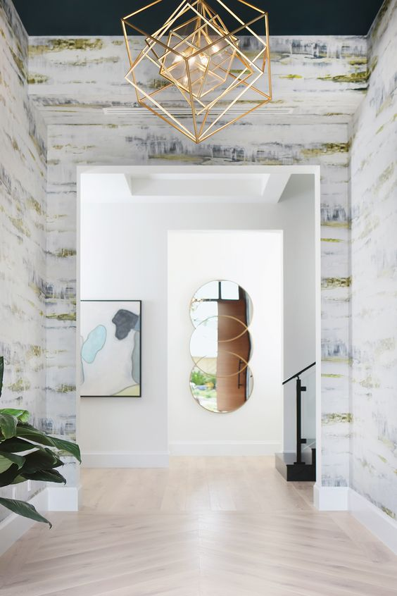a fantastic brass cube chandelier changes the entryway at once and makes it bold