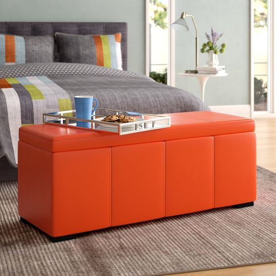 a stylish and modern bright ottoman with a storage space can be used in a bedroom, too
