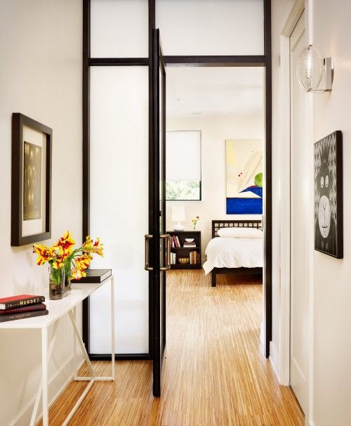 frosted glass doors, even with dark framing, separate your spaces gently without visually decresing the amount of space