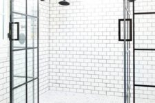 20 white subway tiles with black grout on the walls make up a cool combo with black and white mosaic tiles on the floor