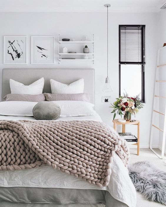 a chunky knit blanket and velvet pillows are right what you need to cozy up your bed