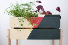 21 a color block Knagglig box placed on wooden legs can become a cool plant stand
