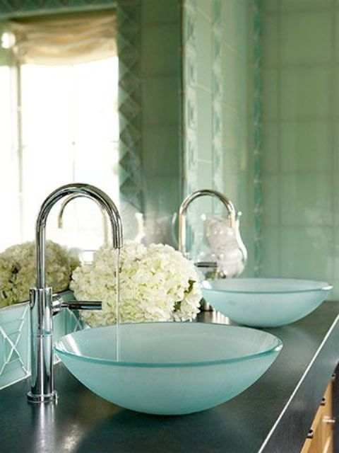 a duo of blue frosted bowl sinks is a cool and fresh take on traditional round sinks