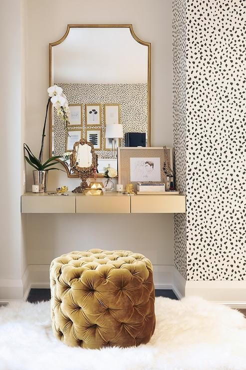 a refined makeup nook with a cool mustard velvet tufted pouf with storage inside
