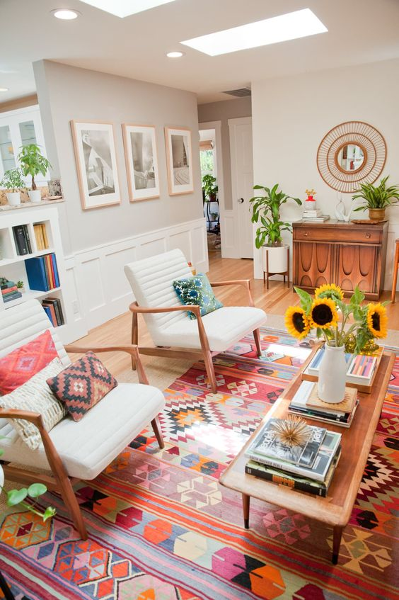 a tribal rug and pillows bring a boho feel to this mid-century modern living room