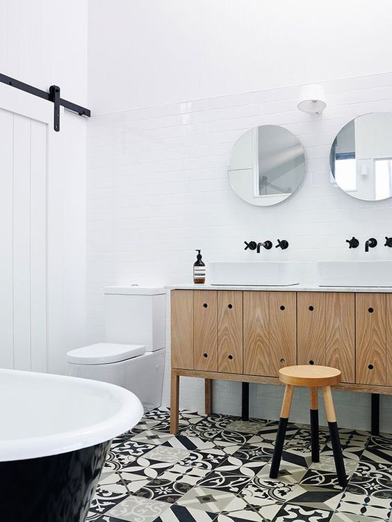 white tiles on the floors for making up a neutral space and black and white mosaic tiles on the floor for a statement