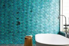 22 a bold turquoise fish scale tile wall is a statement in the bathroom, and neutral grey tiles on the floor