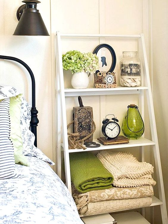 a ladder by your bed can easily substitute a usual bedside table and will take less space